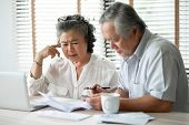 Serious Asian Senior Couple Thinking About Their Debts With Laptop Computer. Saving, Financials, Mon poster