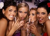 Beautiful hot girls having party fun, drinking champagne.