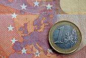 Euro Coin On Euro Map From Banknote Revers. Detailed Close Up Of An One Euro Coin On A Ten Euro Bank poster