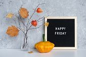 Happy Friday Text On Black Letter Board And Bouquet Of Branches With Yellow Leaves On Clothespins In poster