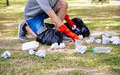 Cropped Casual Man In Red Gloves Collecting Garbage In Park For Social Contribution On Summer Day poster