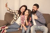 Selfie. Happy Family At Home. Modern Smartphone. Little Girl Use Smartphone With Mother And Father.  poster