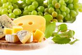 Various types of cheese composition and grapes