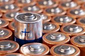 Multiple Used Aa Alkaline Batteries Are Seen Arranged In A Pile. Closeup Side View From The Plus Sid poster