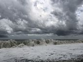 Storm At Sea, Storm Warning On The Coast. Thunderclouds And Big Sea Waves During A Storm. Restless S poster