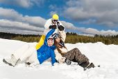 stock photo of wallow  - Young people are enjoying the sun and snow wallowing in the snow - JPG