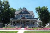 pic of victorian houses  - a colorful and lovely landscaped victorian type house - JPG