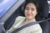stock photo of seatbelt  - Portrait of woman sitting in car wearing seatbelt - JPG