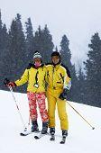 Couple Skiers Under Snowfall