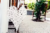 Wedding chairs with heart decoration