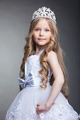 foto of tiara  - Studio portrait of pretty little girl in tiara - JPG