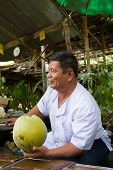 Coconut Seller at Damnoen Saduak Floating Market, Thailand