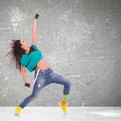 modern style dancer screaming and pointing up on studio background
