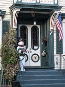 stock photo of stockade  - A snowman greets visitors to a home in the Stockade section of Schenectady New York - JPG