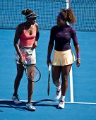 MELBOURNE - JANUARY 22: Venus (L) and Serena Williams of the USA in a doubles match at the 2013 Australian Open on January 22, 2013 in Melbourne, Australia.