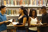 image of librarian  - group of african american students in library - JPG