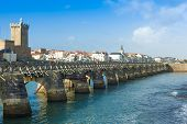 LES SABLES D'OLONNE, FRANCE - DECEMBER 25. Sightseers on archway bridge on the Canal of La Chaume on