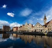 Europe Belgium medieval town travel background - Ghent canal and Graslei street on sunset. Ghent, Be
