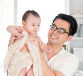 Asian father and six months old baby girl