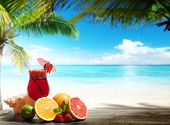 image of mojito  - strawberry cocktail and tropical fruit on the beach - JPG