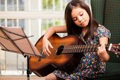 Cute little girl playing the guitar