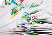picture of piles  - Pile of paper with colorful clips  - JPG