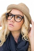 Thoughtful trendy blonde with classy glasses posing on white background