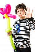Child Refusing to be Photographed During his Birthday Party. Over White Background. Serious Face