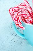 Candy Canes In A Light Blue Cup
