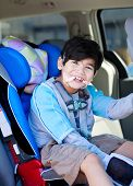 Handsome Disabled Six Year Old Boy Smiling In Carseat