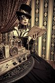 foto of steampunk  - Portrait of a beautiful steampunk woman over vintage background - JPG