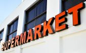 picture of sign board  - Entrance to supermarket with red signboard close - JPG