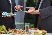 stock photo of buffet lunch  - Business people at the meeting at lunch buffet