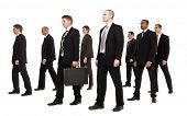 Group of businessmen walking in the same direction