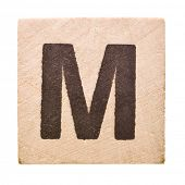 Block with Letter M isolated on white background