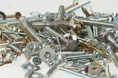 Screws, Nuts, And Bolts On Isolated White Background