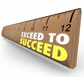 The words Exceed to Succeed on a wooden ruler from school to illustrate getting extra credit or going above and beyond expections to achieve success