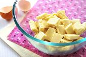 Bar Of White Chocolate Broken Into Pieces In A Glass Bowl