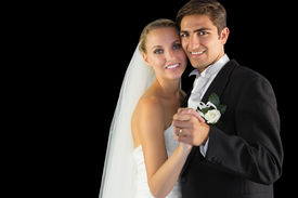 image of waltzing  - Smiling married couple dancing viennese waltz smiling at camera - JPG
