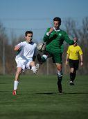 KAPOSVAR, HUNGARY - MARCH 1: Unidentified players in action at the Hungarian National Championship U17 game between Kaposvar (white) vs Ferencvaros (green) March 1, 2014 in Kaposvar, Hungary.