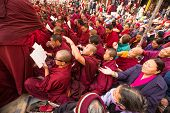 KHATMANDU, NEPAL - DEC 17, 2013: Unidentified tibetan Buddhist monks near stupa Boudhanath during fe