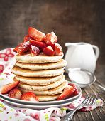 stock photo of buttermilk  - Stack Of Pancakes With Fresh Strawberry on plate - JPG
