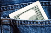 Blue Jeans Pocket With Hundred Banknotes