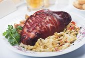 Roasted pork knuckle with spicy potato and sauerkraut