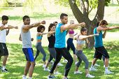 Group of multiethnic friends exercising in park