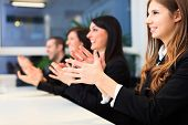 stock photo of applause  - Group of business people applauding - JPG