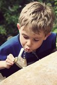 Young boy drinking at a water fountain