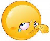Sad orange wiping tear