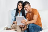 Casual young couple with tablet