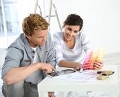 Couple in new home choosing wall paint colours